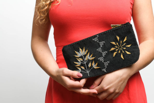 Black cosmetic bag with orange flower embroidery from Sandmade